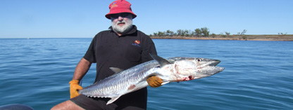 guest holding spanish mackerel
